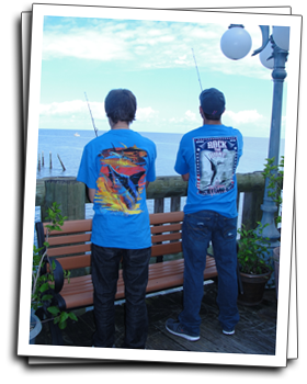 two guys wearing Guy Harvey graphic shirts while fishing