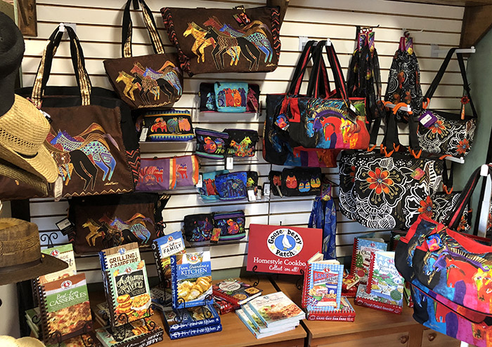 handbags and purses on the wall